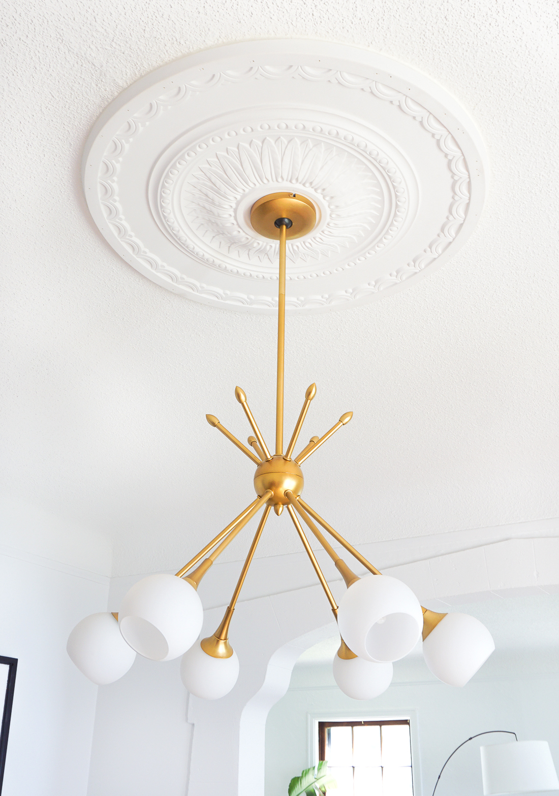 How to center a light fixture using a ceiling medallion francois and i have to say i love the way the traditional ceiling medallion pairs with a more modern fixture perfection if you ask me arubaitofo Images