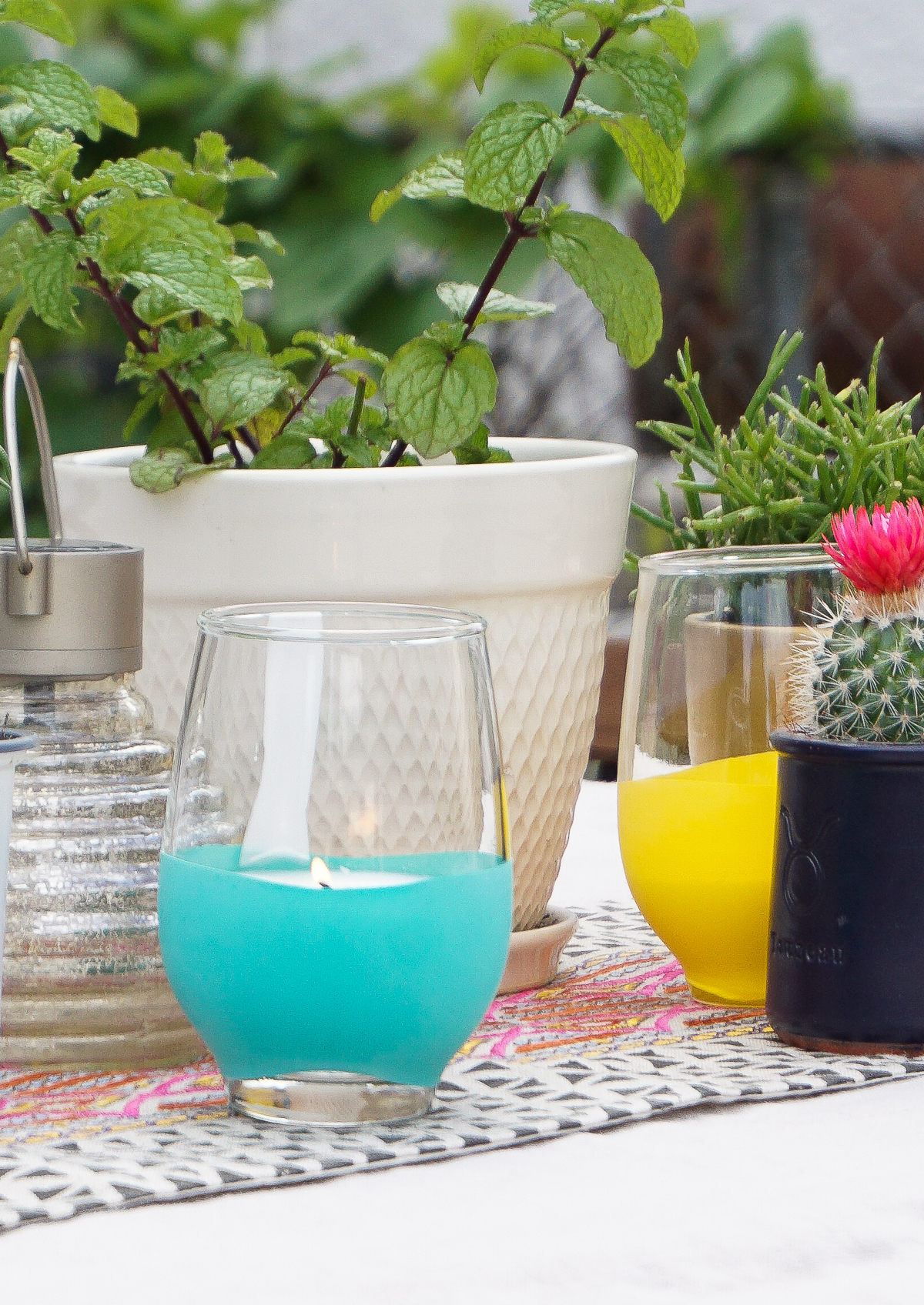 keep the bugs at bay with diy citronella candles